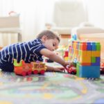 child playing in playroom