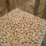 Modern shower with pebble flooring