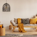 living room with chandelier and yellow accents